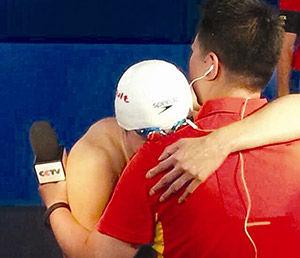 世锦赛上孙杨拿到中国首金后抱着记者痛哭